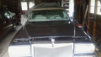 Midnight blue whith multi. Flex's 1990 cadi brough also new work  lots of new  under the  hood  Toledo