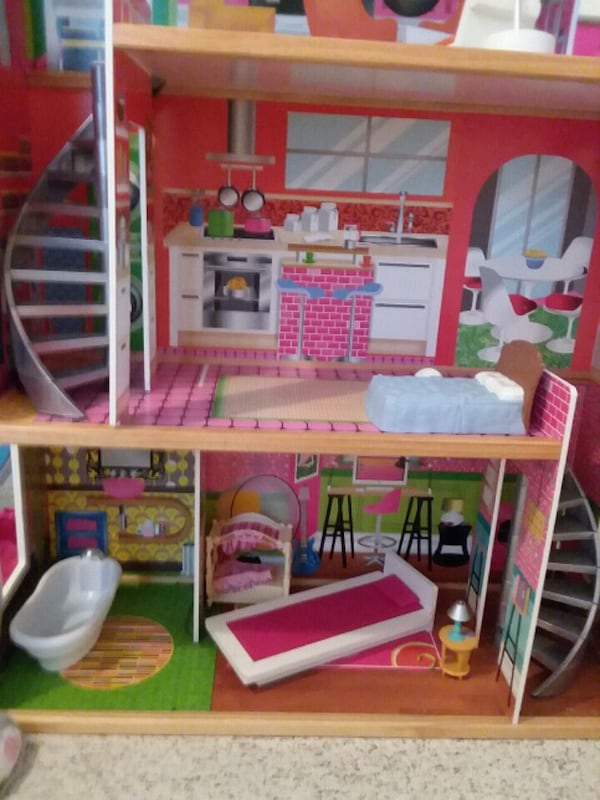 Large doll house like new. Roughly 4 foot tall.  0efc9e61-797c-4f9d-9675-9c82c53c1c91