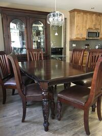 rectangular brown wooden table with six chairs dining set Welland, L3B 0A7