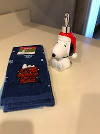New peanuts towels and soap dispenser