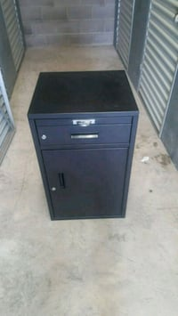 black file cabinet with lock and key