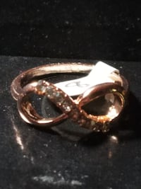 New, Rose Gold Color, Crystal Chip, Infinity Ring, Sizes 7,8 & 9. (Must pick up or ask about mail order. We now take credit cards. See Billy's Bargains on Pueblo Facebook Groups) Located on the South Side of Pueblo. Thank you.   https://www.facebook.com/g Pueblo