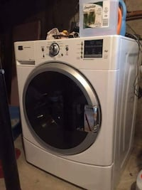 White front-load clothes washer (maytag)