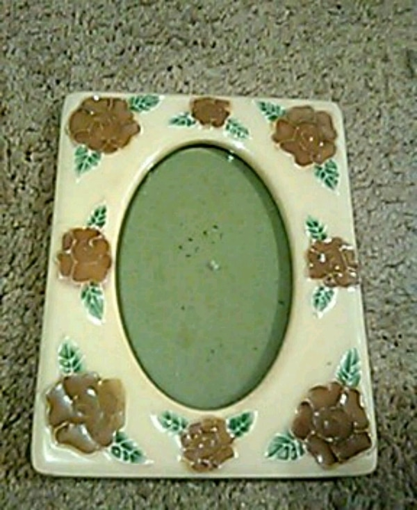 white and green floral ceramic frame