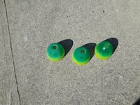 three green-and-yellow earbud foams
