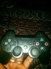 black Sony PS3 game controller 2294 mi