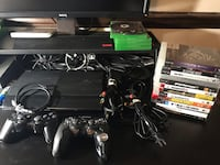 PS3 slim 120GB with 2 controllers and 12 games 57 mi