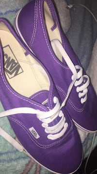pair of purple Vans low-top sneakers