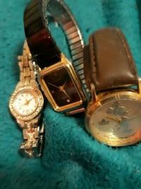 two round gold analog watches