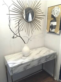 Gorgeous new white marbleized glass console table with jewelled handles and gold legs. Bought but it doesn't fit where I needed in my space.  3.5 ft x 1.5 ft.  Pick up only near high park Toronto Toronto, M6P 1L9