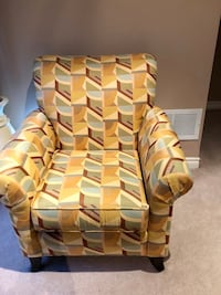 brown and beige fabric sofa chair null