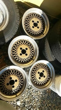 four white multi-spoke car wheels Roseville, 95678