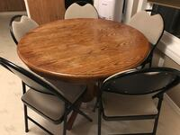 round brown wooden table with four chairs dining set Regina, S4R