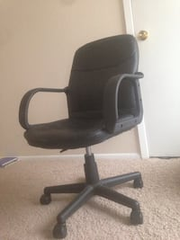 black leather padded rolling armchair 1202 mi
