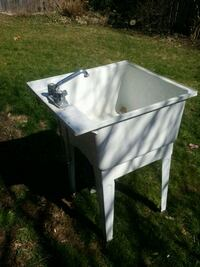 white ceramic sink with faucet St. Catharines, L2M 7J6