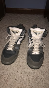 pair of black-and-white Nike basketball shoes Independence, 64057