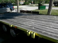 gray and yellow freight truck open trailer Palm Bay, 32908