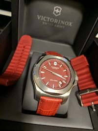 round silver analog watch with red strap Calgary