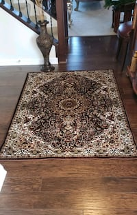 Brown and cream color, new, 4'by6' area rug.