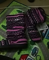 pair of pink-and-black aztec snow boots