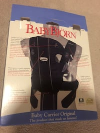 BABYBJORN® Original Baby Carrier in Dark Blue  Used and in great condition.   Details Easily carry and promote bonding with your newborn in convenient and comfortable style with the classic BABYBJORN Original Baby Carrier Oakville