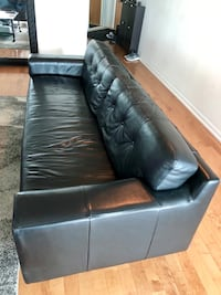 Black leather EQ3 sofa. 7ft long. 34 inches wide. Must be picked up. Can't deliver. Toronto, M5V