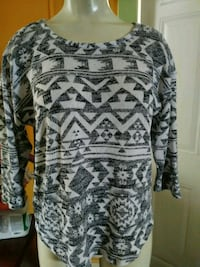 gray and black tribal print scoop-neck shirt