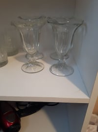 four scallop-edge clear footed glasses Calgary, T2K 0G3