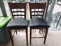 two black wooden framed black leather padded chairs Montréal, H1K 0G2