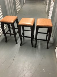 three brown wooden framed black leather padded chairs Derwood, 20855