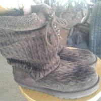 pair of black sheepskin boots 2220 mi