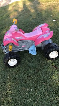 toddler's pink and white ride on toy