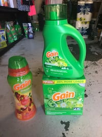 two Gain detergent bottles and one bottle 2251 mi