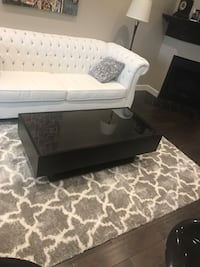 Coffee table with storage and glass top