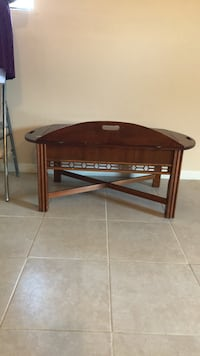 brown wooden framed glass top table Palm Bay, 32907