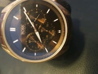 round gold-colored chronograph watch with black le Vancouver, V6G 0B6