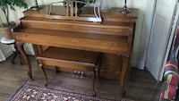 brown wooden upright piano Sandy Springs, 30342