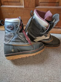 black-and-brown leather snowboard boots