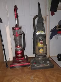 two red and black upright vacuum cleaners Brentwood, 20722