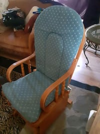 Glider chair, great for rocking a baby or just lounge around
