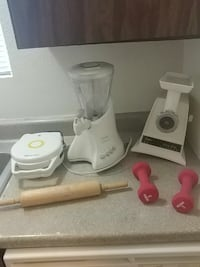 white electric blender; brown rolling pin; two pink dumbbells Spokane Valley, 99216