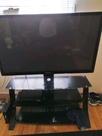 55 inch samsung tv with the stand  Dearborn