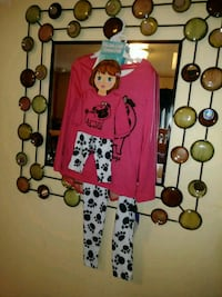 Brand new kids pajamas and a pair for her doll. Amherst