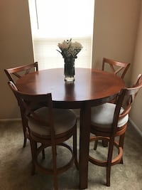 round brown wooden table with four chairs dining set Herndon, 20171