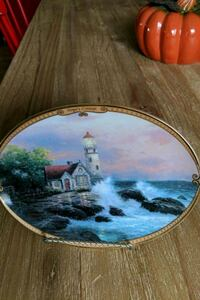 round brown wooden framed painting of house Saint Thomas, N5R 6B9