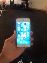 silver iPhone 6 with blue case 610 mi