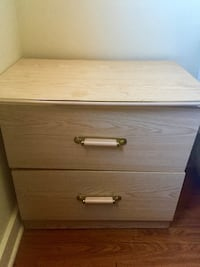 Beig wooden 2-drawer nightstand.