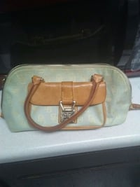 brown and white leather handbag 70 km