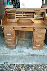 brown wooden roll top desk