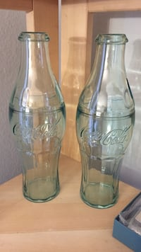 two Coca-Cola bottle cups